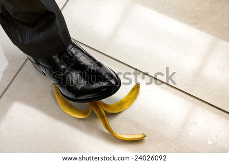men shoe stepping on banana peel, top view. Look for more in MY PORTFOLIO - stock photo
