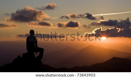 Men silhouette on the sunset background