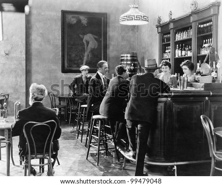 Men sitting around a counter in a bar