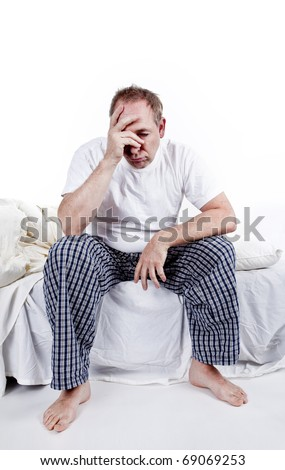 men sitting in bed tired