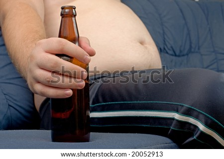 Men sitting on the sofa with a bottle of beer
