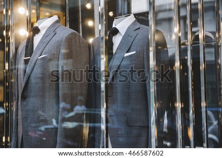 Men suits in a luxury clothing shop