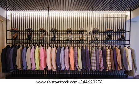 Men suits in a luxury fashion store - stock photo