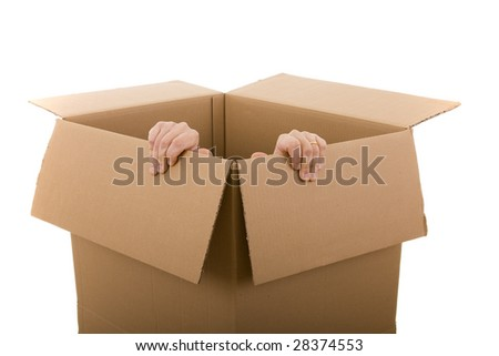 men trying to escape from a cardboard box (selective focus) - stock photo