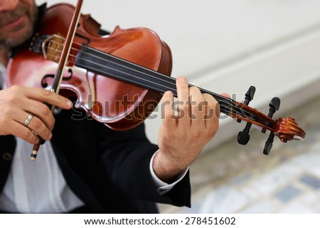 Men Violinist Playing Classical Violin Music in Musical Performance - stock photo