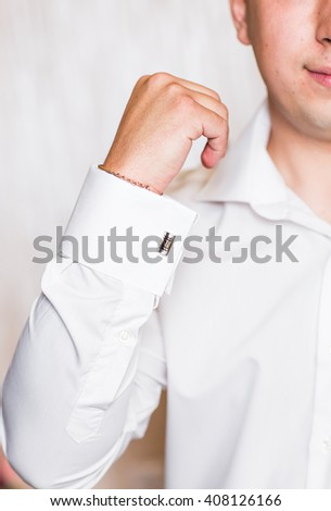 men wear a shirt and cufflinks close-up