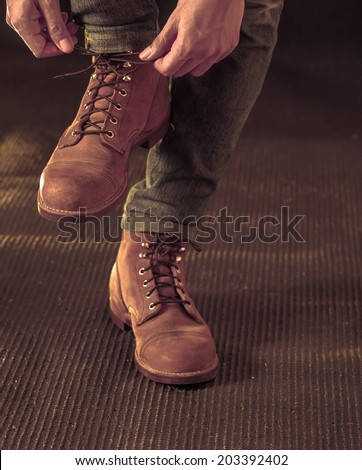 Men wearing work boot - stock photo