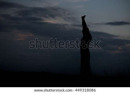 Men, who welcome sunrise with raised hands and enjoying landscape.
