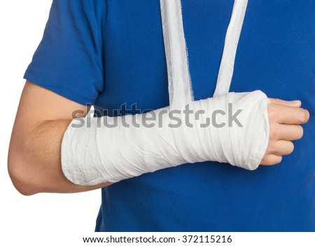Men with plastered hand on white background                             - stock photo