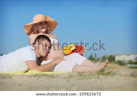 Men with pregnant woman - stock photo