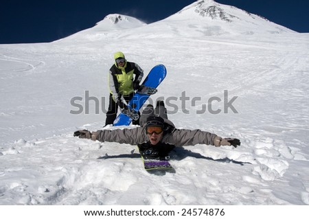 Men with snowboards