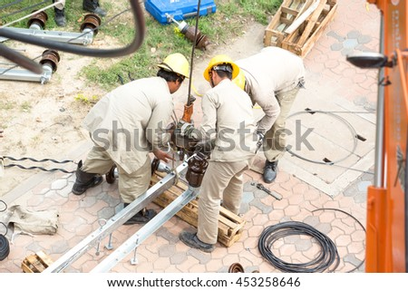 men working on a transformer on a electricity power pole in Thailand., Date: 13 June 2559 - stock photo