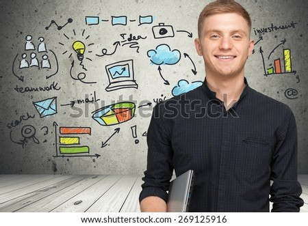 Men. Young student with laptop smiling - stock photo