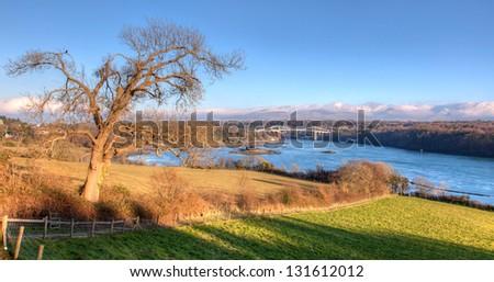 Menai Bridge and the Menai Straist from the Isle of Anglesey North Wales - stock photo