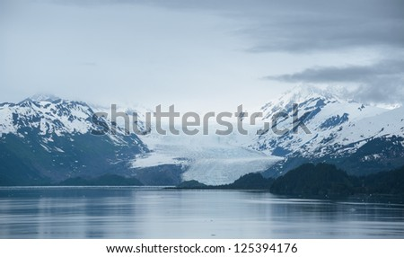 Mendenhall Glacier and calm water of Alaska's fjords - stock photo
