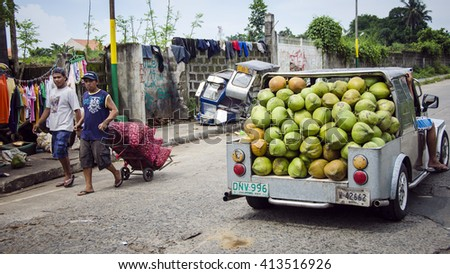 Mendez city, Philippines - July 14, 2012: Street scenes featuring market stalls and Jeepneys in Mendez City on the main island of Luzon in the Philippines - stock photo