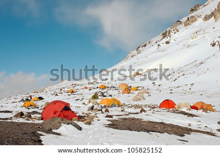 MENDOZA, ARGENTINA  - JAN 16: Nido de Condores high altitude camp at 5.500 meters. This year, 35 thousand people intended get the summit of the mount. Jan 16, 2012 in Aconcagua Mount, Mendoza, Argentina. - stock photo