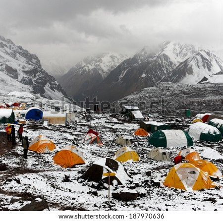 MENDOZA, ARGENTINA - JAN 18: Plaza de Mulas base camp covered of snow in summer. This year, 5400 people faced the mountain intend to get the summit. Jan 18, 2014 in Aconcagua Mount, Mendoza, Argentina - stock photo