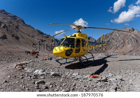 MENDOZA, ARGENTINA - JAN 15: Rescue Helicopter at Plaza de Mulas .  Org. help manage the risk of climbing. This season 140 people were evacuated. Jan 15, 2014 in Aconcagua Mount, Mendoza, Argentina  - stock photo