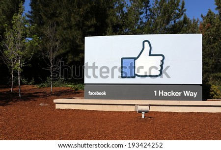 MENLO PARK, CA - MARCH 18: A sign at the entrance to the Facebook World Headquarters located in Menlo Park, California on March 18, 2014. Facebook is a popular online social networking service. - stock photo