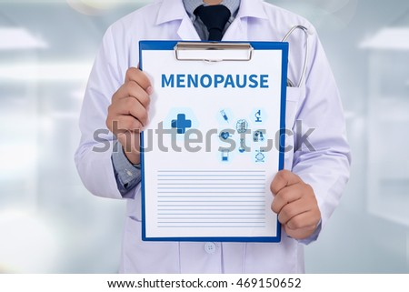 MENOPAUSE Portrait of a doctor writing a prescription
