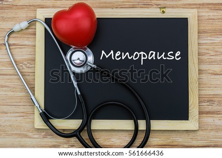 MENOPAUSE wording on chalk board with red heart and stethoscope, health medical technology information concepts