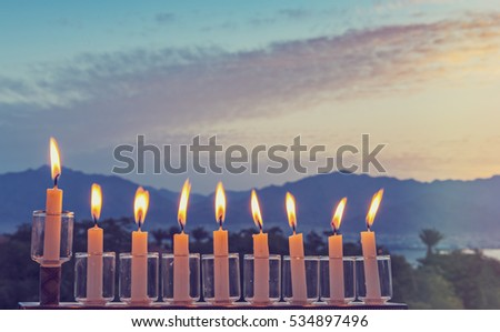 Menorah is a major traditional Jewish symbol for Hanukkah holiday. Image toned for inspiration of vintage style and festive mood