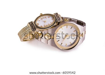 Mens and ladies gold and silver wrist watches on a white background. - stock photo