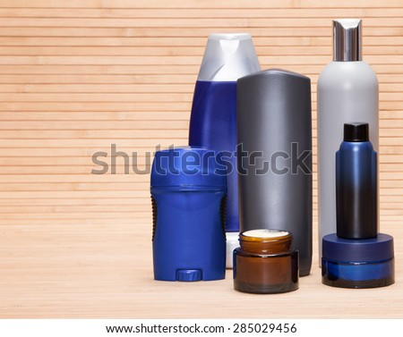 Mens cosmetics. Various cosmetic products for men on a wooden surface. Copy space - stock photo
