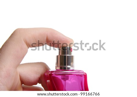 Mens hand and bottle of perfume isolated on white - stock photo