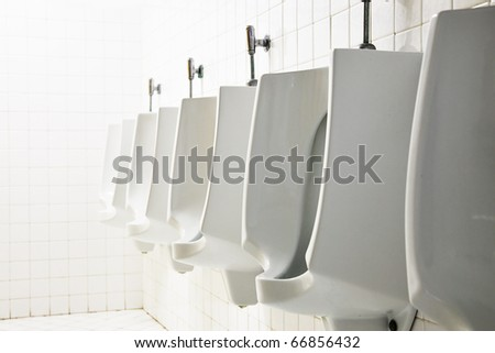 Mens public toilet - stock photo