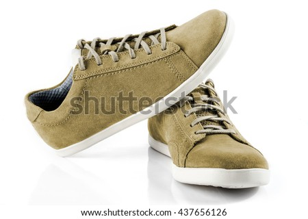 Mens suede shoes of mustard colour isolated on white background - stock photo