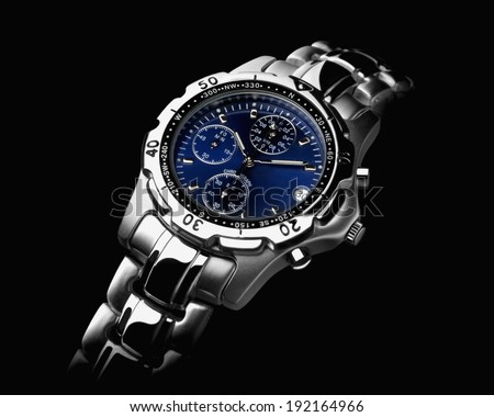 Mens wrist watch on black background  - stock photo