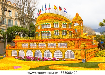 MENTON, FRANCE - FEBRUARY 14, 2016: Art made of lemons and oranges in the famous Lemon Festival (Fete du Citron) in Menton, France. The famous fruit garden receives 230,000 visitors a year.