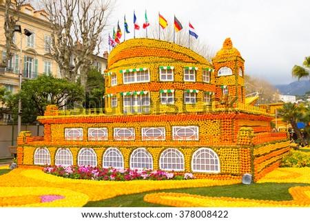 MENTON, FRANCE - FEBRUARY 14, 2016: Art made of lemons and oranges in the famous Lemon Festival (Fete du Citron) in Menton, France. The famous fruit garden receives 230,000 visitors a year. - stock photo