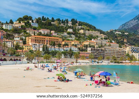 MENTON, FRANCE - JUNE 13, 2016: Colorful old town and beach in Menton on french Riviera in a beautiful   summer day, France on June 13, 2016