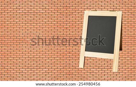 Menu blackboard on wall Red Brick background - stock photo