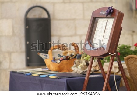 Menu board outside a restaurant in Montenegro - stock photo