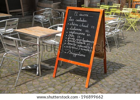 Menu by the sidewalk cafe on Brussels street - stock photo