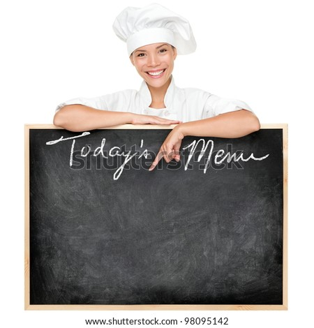 Menu sign. Restaurant chef showing menu blackboard sign written Today's Menu. Young woman cook or chef isolated on white background. - stock photo