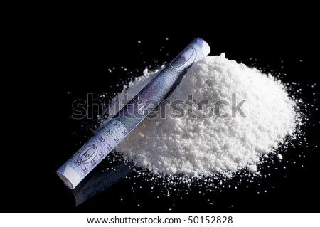 Mephedrone (aka meow, bubbles) powder on black background with rolled up twenty pound note - stock photo