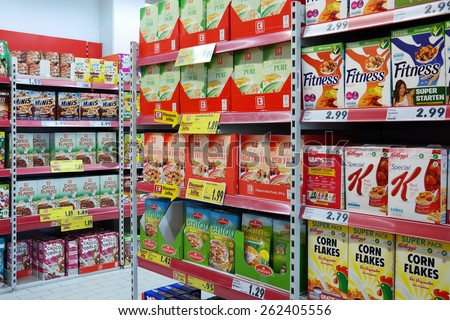 MEPPEN, GERMANY - FEBRUARY 27: Breakfast cereal products in a Kaufland hypermarket, a German hypermarket chain, part of the Schwarz Gruppe. Photo taken in Meppen, Germany on February 27, 2014