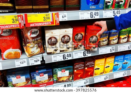 MEPPEN, GERMANY - MARCH 2: Selecting coffee on a shelf with a variety of coffee products of different brands in a Rewe supermarket. Foto taken on March 2, 2016 in Meppen, Germany