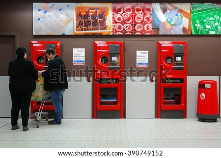 MEPPEN, GERMANY - MARCH 2, 2016: Shoppers return their bottles and cans of reusable packagings in a reverse vending machine. Photo taken on March 2, 2016 in a Kaufland Hypermarket in Meppen Germany. - stock photo