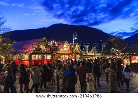 Merano, Italy - December 14, 2013: Traditional Christmas market along the Passer River in the old town of Merano. Italy. - stock photo