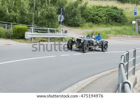 Merano, Italy - July 08, 2016: Riley Nine Racing special on Scena road in the direction of Scena village while the South Tyrol classic Scena Rally. Sven Horstmann driver with co-driver Marcus Ferstl