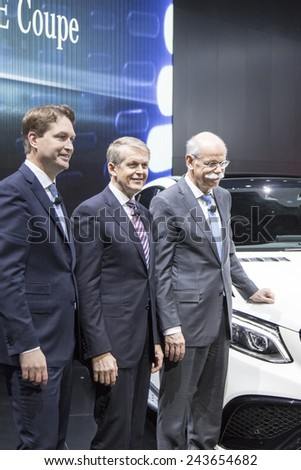 Mercedes-Benz CEO Dieter Zetsche, Thomas Weber, Board of Management, and Ola Kallenius,  management at The North American International Auto Show January 12, 2015 in Detroit, Michigan. - stock photo