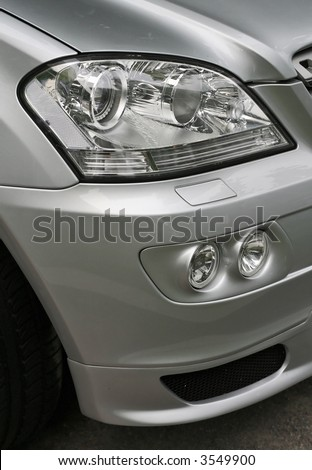 Mercedes M-Class headlight - stock photo