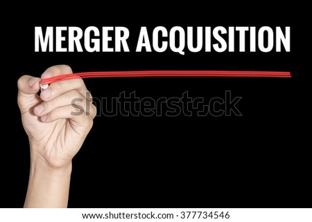 Merger Acquisition word writing by men hand holding red highlighter pen on dark background - stock photo