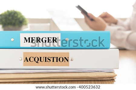 Mergers and Acquisitions document place on desk in meeting room.